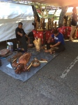 local artists carving at Aloha swap meet