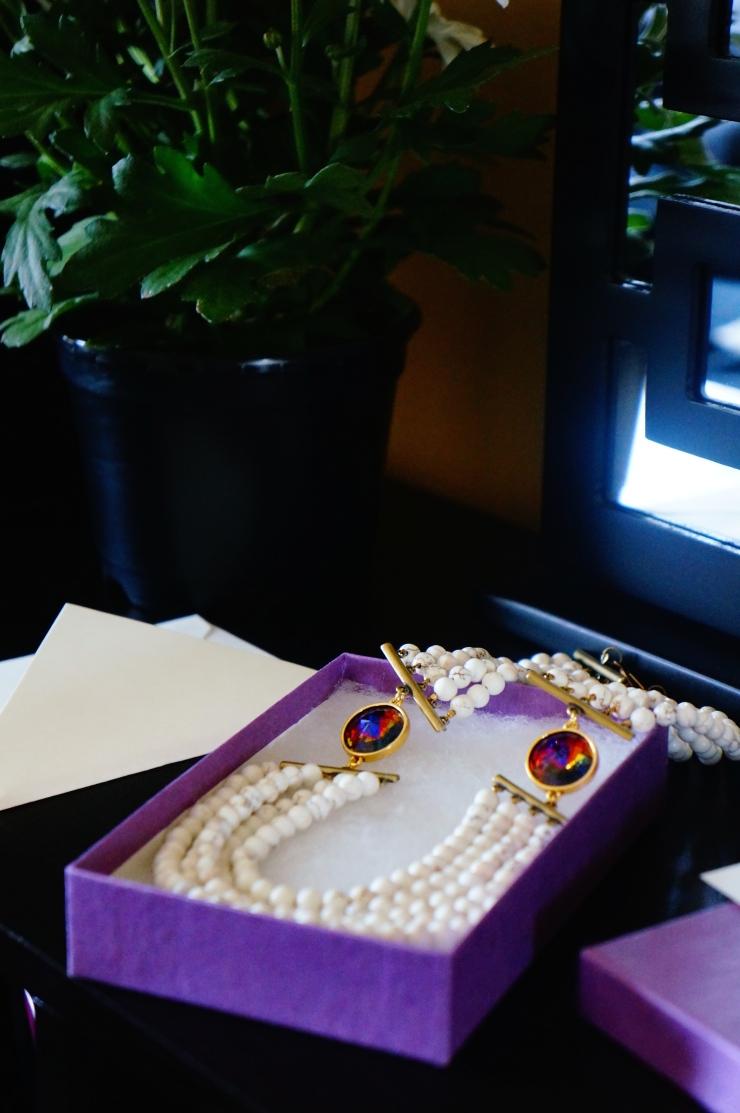 white muti-strand statement necklace by oyindoubara